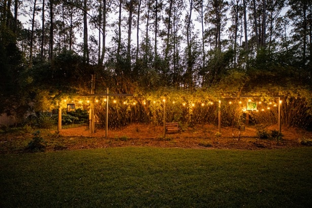 Backyard lit with decorative lighting at Sailor's Rest on Johns Island, SC.
