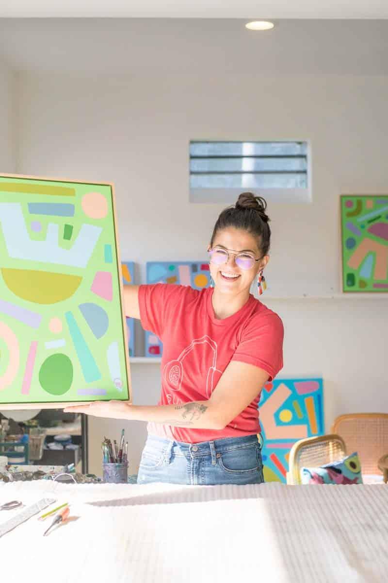Julia Deckman holding a beautiful piece of art she created.