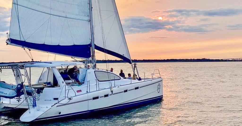 A catamaran on the Charleston Harbor enjoying the sunset.