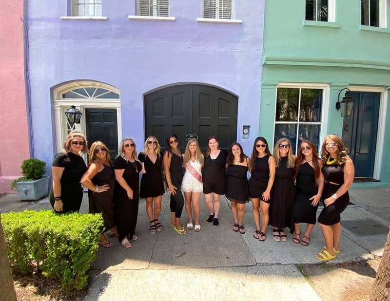 Group photo in front of Rainbow Row in downtown Charleston, SC.