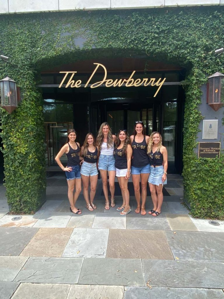 Laura and her girls posing for a photo outside of The Dewberry in Charleston.