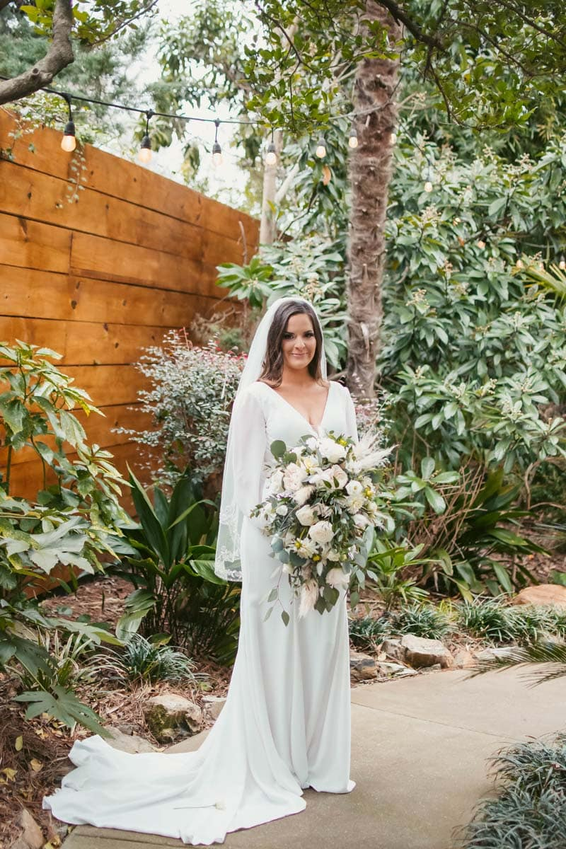 Professional photo of the bride at her wedding in Charleston, SC by Brie Sciales Photography.