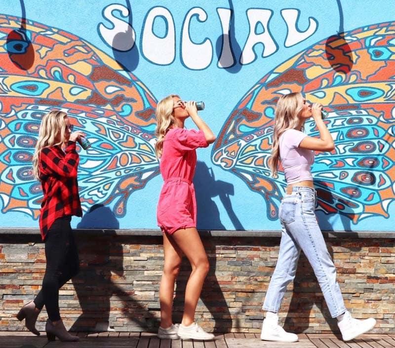 3 girls posing for a creative shot at the Uptown Social / Bodega in Charleston, SC.