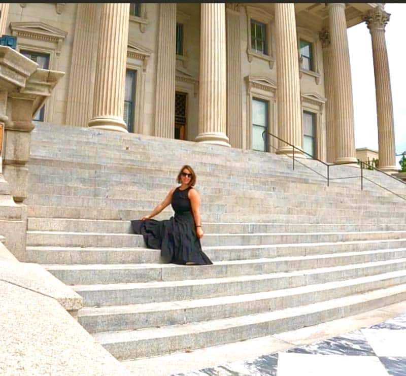 Silvia Vidova posing for a picture on steps.